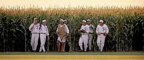 Ball players walking out of a corn field